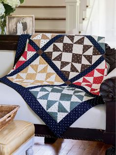This fat quarter friendly quilt, Attic Treasures, features hourglass unit blocks in an old country color scheme and navy sashing between blocks.