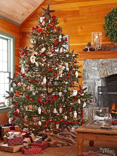 Bring a cozy cabin vibe to your home by decking out your tree in traditional favorites. Red ribbon garland, pinecone stars, and woodland creature ornaments make for a rustic scheme. Add plaid details, like wrapping paper and ribbons, to complete the look in a way that's both classic and on-trend.