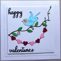 Materials: Dee's Distinctively - Chickadee (just used the small wing) Memory Box - Happy Valentine's Day & Perched Reed Bird Nuvo Collection Aqua Shimmer - Glitter pen Penny Black - Heart String Poppy Stamps - Trailing Vine Spellbinders - Large Squares
