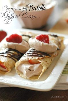 Simplified blender crepes are filled with a light and fluffy Nutella whipped cream and fresh strawberries! This is one dessert that is sure to impress.