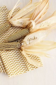 All it takes is a coat of metallic gold spray paint to turn plain old corn into the most glam element of your tablescape. Click through for more amazing Thanksgiving place card ideas.