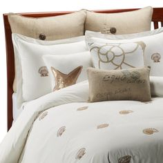 Coastal Life Luxe South Island Duvet Cover, 100% Cotton - Bed Bath & Beyond I Embroidered beige seashells dance upon the crisp white fabric of this duvet cover, bringing the relaxing style of the shore with a simple statement. The soft cotton and understated style offer instant calm and relaxation for your bed.