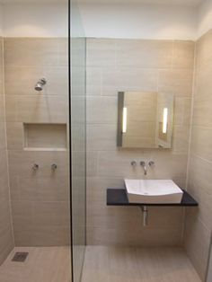 Small but bright and warm. Has the cute built in shelf in the shower. Check out my blog: http://www.wet-room-screens.co.uk/