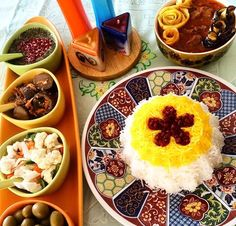Such beautiful display of food. Iranian rice with barberries and pickled vegetables, side dishes.