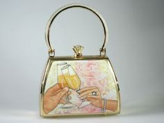 """Debbie Brooks petite sassy gold frame and gold satin """"Toast"""" handbag.  We sell the complete collection at our store Renaissance Fine Jewelry. Find us at www.vermontjewel.com, Facebook, twitter and at 1-802-251-0600."""