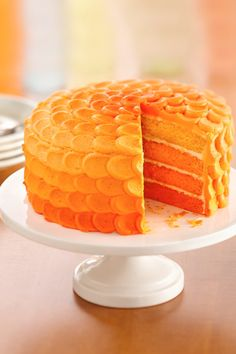 A gorgeous orange ombre cake that you can make in five simple steps! This trendy beauty is almost too pretty to slice (almost!), and would make a lovely addition to a birthday or rainbow-themed party. Bonus: it's flavored with orange juice and orange gelatin.