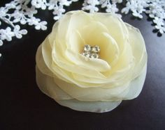 Pale Yellow Hair Flower Pale Yellow Flower Bridal Updo Rhinestones Light Yellow Head Piece. $18.00, via Etsy.