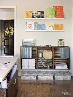 Jenna stained crates purchased from a crafts store before screwing them to wall studs and to each other to create storage perfectly sized for her binders./