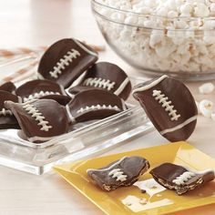 Super Bowl snack idea. Dip Pringles in chocolate and draw the threads on with white icing or chocolate