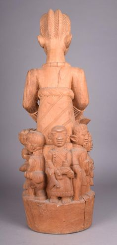Lot 348 - A Yoruba carved maternity figure by Lamidi Olonade Fakeye, with a seated female and a suckling