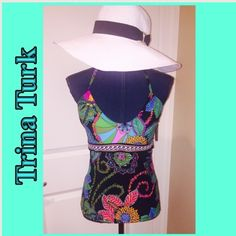 Trina Turk Sea Garden Tankini Top Size 8 Like From Like  Trina Turk, this tankini top Size 8 Bust Size B Or C the most features: removable soft cups, no underwire scoop neckline adjustable shoulder straps fully lined nylon/spandex hand wash Imported. Trina Turk Swim Bikinis