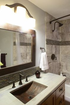 Colours & Concepts Interior Design/Build Bath Remodel contemporary bathroom featuring Native Trails Avila hand hammered copper sink and Sedona Rectangle Mirror