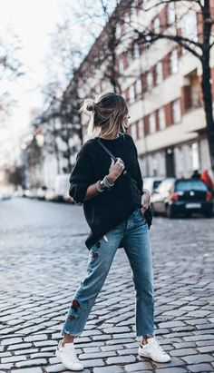 Street style | Black sweater, Jeans, white Adidas sneakers ans a purse