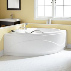 Add a contemporary touch to your bathroom with the Talia Corner Acrylic Tub. Perfect for a master bath suite or guest bath, this tub rests on Ball & Claw feet. Pair with a freestanding tub filler to complete your look.