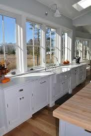Image result for sconces over kitchen sink