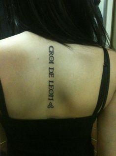Heart of a lion in gaelic. This is one of the best ways I have seen words done as a tattoo.