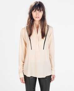 JACQUARD BLOUSE WITH PIPING from Zara  Straight cut with long sleeves. Mao collar with concealed button fastening. Yoke with contrasting piping.