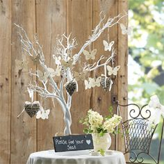 A white tree to hang the table arrangements on - one piece of card per table. Decorative and stylish. Craft Ideas