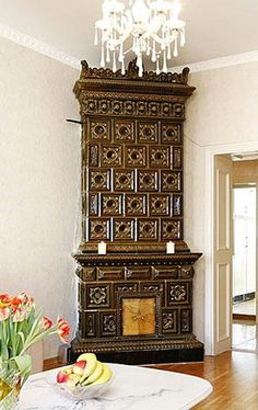Green-brown stove with bowl shaped tiles. A copy of a Rörstrand stove, made 1895. Height 300 cm, Plinth 45 x 118 cm.