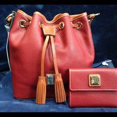 """Host Pick D & B Pebble Grain Kendall Set Beautiful pebble grain leather Kendall crossbody in a gorgeous wine color with brown leather train. Interior lined in red cotton includes; one zip pocket, one cell pocket and key leash. Adjustable strap drop of 25"""".  Comes with matching pebble grain leather flap wallet. Wallet measures 4.5"""" X .75"""" X 4"""" closed and has six credit card slots, one bill slot, four inside pockets and one exterior zip pocket. Snap closure. Bag comes with dust cover. Brand…"""