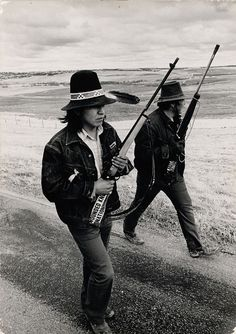 Two Lakota men from the American Indian Movement at Wounded Knee, South Dakota, 1973.  Photo credit: Michael Abramson