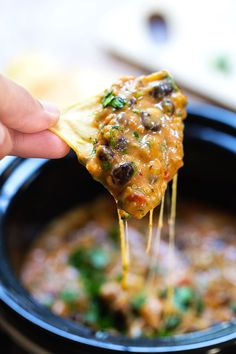This Homemade Cheesy Chili Dip is made without the processed cheese! Just homemade spicy chili and creamy cheese sauce. Deeeelish!
