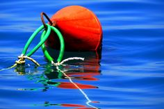 https://flic.kr/p/fr7Qmz | Red buoy | Closeup view of buoy and ropes in the blue waves. Symi island, Dodecanese, Greece