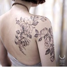 Peony tattoos on the right shoulder and upper arm. Tattoo Artist: Zihwa