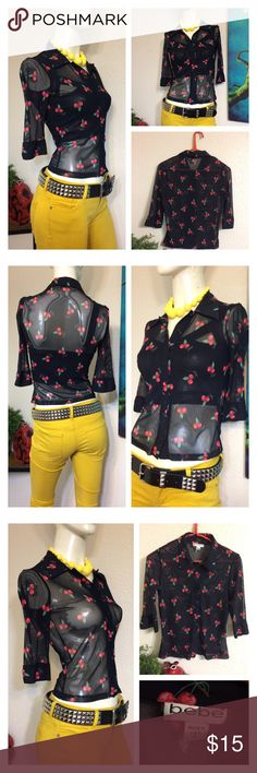 """Bebe Cherry Print Blouse Rockabilly Bettie Page Great pre owned condition!!! Marked size medium because its stretchy but will also fit a size small Approx measurements laid flat-(double where necessary) Shoulder to shoulder: 14"""" Underarm to underarm: 15.5"""" Waist: 13"""" Shoulder to hem: 20"""" Sleeve: 13.5"""" I ship paid items everyday at 1 pm.  Thanks!!! bebe Tops Button Down Shirts"""