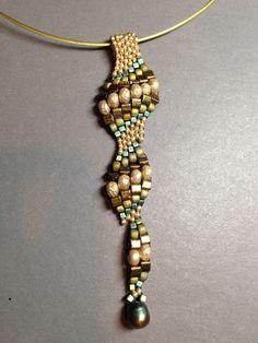 Seed bead woven pendant. Beth Stone