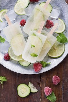 MOJITO POPSICLE (makes 8) 2c sparkling water 1 lime Mint 3 tbsp brown sugar 1/2 tsp of rum   Cut 8 thin lime slices. Mix water, brown sugar and lime juice from the remaining lime, until the sugar has totally dissolved. Keep 8 spare mint leaves and steep the others in the sweet water for at least 10 min. Place a lime slice and a mint leaf in each popsicle. Taste and adjust sugar before straining. Mix in rum, pour into popsicle molds. Freeze.