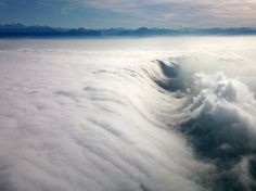 Cloud waterfall, spotted by Captain Gianni on final approach to runway 23 in Geneva Switzerland.