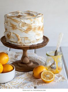 This Lemon Meringue Cake is bright, fresh and sure to impress! Lemon poppy seed cake with lemon curd and toasted meringue frosting. Recipe by Tessa Huff for TheCakeBlog.com.