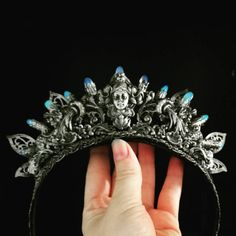 Be the queen with this beautiful art nouveau crown set with filigree and opalite crystals. This piece is made to order so please allow around 6-8 weeks to complete an order.  Image courtesy of Kika von Macabre