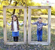 Adorable kids posed inside picture frames in open space fall session Denver, Colorado Family Photographer - The Vintage Cupcake Photography
