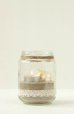 Candle in jar with lace and sand, I would have done this if I had a beach wedding