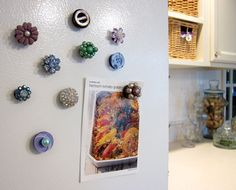 Good way to repurpose costume jewelry when one of the pair has gone missing -- glue to a magnet, use as a fridge magnet. Costume jewelry fridge magnets!