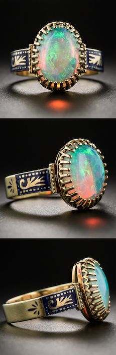 Mid 20th-century 18K Opal and Enamel Ring,  A luminous multi-chromatic opal - predominantly cool blues and greens with prominent orange flashes - held in place by  26 prongs, atop a Victorian style mounting, hand fabricated in rich 18K yellow gold with cobalt blue enamel ornamentation gracing each shoulder.