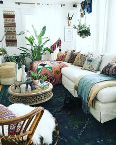 You can add rugs not only on floors but on sofas too. That's a great way to bring additional patterns to the mix. #bohemianhome
