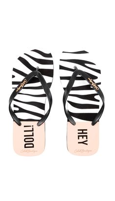 3758a6bc2f Keep your feet cute on vacation with these must-have tiger print Hey Doll  logo Flip flops. Black rubberized toe strap with the CB logo and Hey Doll  printed ...