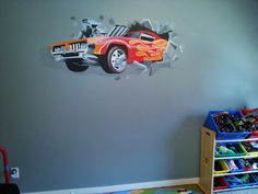 Hot Wheels mural of car crashing through wall was painted as a mural in a boy's bedroom in Portland, Oregon. Now available on a variety of products at Society6.com/MelissaJBarrett and Zazzle.com/MuralsArtCreations.  Hand painted murals in Salem and Portland, Oregon at MBPaintDesign.com.