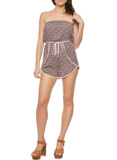 Rainbow Printed Strapless Romper with Braided Belt | Complete your summer wardrobe with this strapless romper, featuring a playful geometric print, braided belt and side overlays trimmed with pompoms. Finish this feminine style with strappy flat sandals, aviators and a crossbody bag for the perfect music festival outfit.