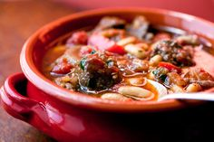 Spanish-Style Lamb Stew Recipe Soups, Main Dishes with olive oil, lamb stew meat, salt, pepper, onions, red bell pepper, garlic cloves, pimenton, whole peeled tomatoes, red wine, chicken stock, sherry vinegar, bay leaves, white beans, fresh parsley