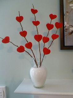 Here's a simple thing to do with a vase, some twigs, and cute little heart cutouts. It's a good project for little kids out there.
