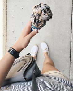 A scoop of cookies and cream, a crossbody bag, striped tee, shorts, and comfy sneakers.