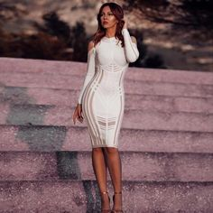 29eab1c6fec3  Annita  in pure white midi dress with shear details all over the body. We  suggest to pair it with white high heels.