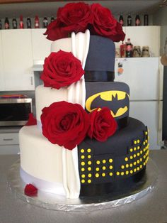 Our wedding cake: half traditional half batman - Maybe with deep blue or purple roses instead.