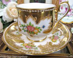 ROYAL ALBERT TEA CUP AND SAUCER ROYALTY GOLD PATTERN TEACUP BEADED FLORAL. VERY PRETTY!