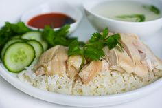 Hainese Chicken Rice - the rice is cooked in the chicken broth and the poached chicken is eaten with a chili dipping sauce