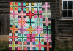 How's about this for a bright and colorful quilt? I feel a bit like a walking ad for Cotton +...